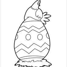 Coloriage : Poule de Pâques couvant un oeuf
