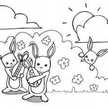 Coloriage : Lapins de Pâques et leurs oeufs