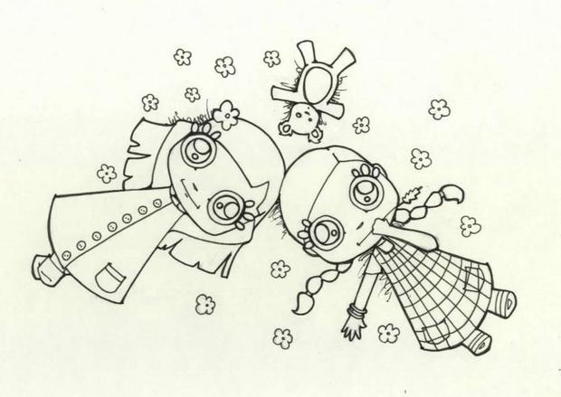 Coloriage de deux petites filles couchées dans l'herbe