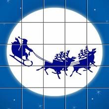 Le traîneau du père Noël passe devant la lune